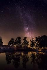 Glow - Lueur (olivier_kassel) Tags: nuit night sky ciel étoiles stars voielactée milkyway reflets reflection canal boat bateau longexposure poselongue eau water arbres trees