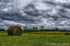 Hay Bale and Stormy Sky (travelphotographer2003) Tags: september roundhaybale nicholascounty westvirginia solitude alleghenymountains appalachianmountains beautyinnature freshness purity refreshment tranquilscene stormysky rural traditional serenity green beauty serene forcesofnature