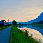 Early summer morning at the river Inn between Kiefersfelden and Kufstein with Kaiser mountains and Meridian regional train thumbnail