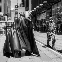 Caped Crusader Confronts Evil (John St John Photography) Tags: timessquare newyorkcity newyork streetphotography candidphotography batman capedcrusader evil streetperformers characters bw blackandwhite blackwhite blackwhitephotos 42ndstreet broadway johnstjohnphotography