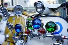 Green and blue (Eric Flexyourhead) Tags: nakanoshima 中之島 kitaku 北区 osaka osakashi 大阪市 kansai 関西地方 japan 日本 city urban detail fragment modsmayday 2018modsmayday osakamodsmayday 2018osakamodsmayday scooterrun mod mods scooter italian vespa headlights headlamps green blue vintage classic retro shallowdepthoffield sonyalphaa7 zeisssonnartfe55mmf18za zeiss 55mmf18