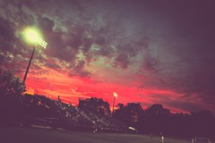 Nevermind The Bullocks, here are The Clouds (Dimi Sahn) Tags: sunset city tree dusk sky night soccer field stands stadium