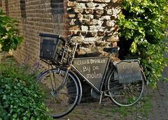 Eating & drinking at the mill (wilma HW61) Tags: fiets bicycle fahrrad vélo ciclismo muur wall struik bush reclame advertisement hattem nederland niederlande netherlands nikond90 holland holanda paysbas paesibassi paísesbajos europa europe outdoor wilmahw61 wilmawesterhoud