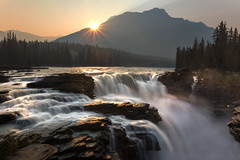 Golden Athabasca Falls Sunrise (NickSouvall) Tags: jasper national park canada athabasca falls water waterfall stream river sunrise smoky golden sunlight light warm color sun star burst rays rocky mountains peaks wildfire landscape nature