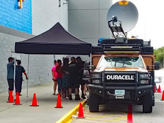 Duracell Battery Station. (dccradio) Tags: lumberton nc northcarolina robesoncounty outdoor outdoors outside walmart store retail bigboxstore duracell powerforward hurricaneflorence florence september earlyfall earlyautumn latesummer monday mondayafternoon wifi powerstation free batteries duracellbatteries batterystation walmartsign words text transportation vehicle ready relief restore truck duracelltruck dish satellite satellitedish wifidish cones pylons curb samsung galaxy smj727v j7v cellphone cellphonepicture