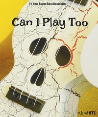 Book Cover (Clare-White) Tags: book cover bestofweek1 face ukulele instrument strings small scary