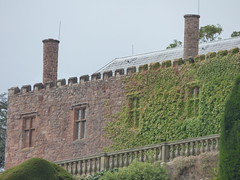 Powis Castle from the Terraces - chimneys (ell brown) Tags: powiscastle castellpowys welshpool powys wales unitedkingdom greatbritain medievalcastle fortress grandcountrymansion robertclive cliveofindia britisheastindiacompany castellcoch castellpool castellpola castellpole castelltrallwng redcastle reddecastle castelcough earlofpowis nationaltrust builtbyawelshprince gruffyddapgwenwynwyn owainapgruffyddapgwenwynwyn barondelapole siredwardherbert edwardclive gradeilistedbuilding gradeilisted redsandstonerubble freestonedressings bodley smirke terraces chimney chimneys powiscastleandgarden