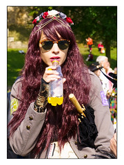 Steampunk with orange squash (Photography And All That) Tags: streetphotography street steampunk steampunkweekend steampunks lincolnsteampunkweekend lincoln lincs girl girls drinking orangesquash orange bottle bottles sony sonyalpha7mark3 sonyalpha sonyilce7m3 ilce7m3 portrait portraits portraiture people candid candids festival festivals event events summer sunglasses sunny sunshine flowers costume costumes period fantasy sci fi face faces expression longhair umbrella