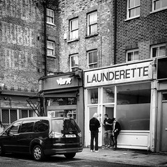 Launderette - with a bonus ghost sign (Flamenco Sun) Tags: bw ghostsign northlondon islington pentonville london launderette laundromat