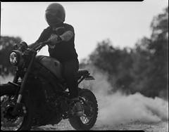Craig from Kickstart garage on 4x5 film (Garrett Meyers) Tags: rbgraflex4x5 garrettmeyers garrett meyers largeformat 4x5film graflex graflex4x5 homedeveloped blackandwhitefilm kickstartgarage craigmarleau motorcycle redding reddingphotographer ridingmotorcycles