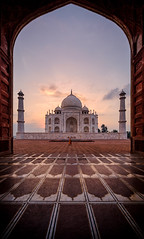 The first of many (ajecaldwell11) Tags: xe3 sunrise ankh taj tajmahal marble doorway fujifilm light mosque building frame minaret india architecture dawn sky wideanglearchitecture clouds agra mahal caldwell