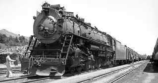 Southern Pacific GS-1 class Northern 4-8-4 oil burning steam locomotive # 4406, is seen leading a passenger train