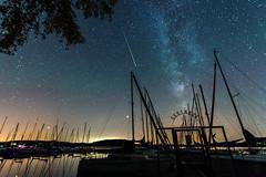 night at the lakeside (Florian Grundstein) Tags: shootingstar milkyway lakeside lake reflection nightshot stars water nature sailing boat