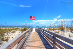 Pensacola Beach & Patriotism (J.L. Ramsaur Photography) Tags: jlrphotography nikond7200 nikon d7200 photography photo 2018 engineerswithcameras photographyforgod thesouth southernphotography screamofthephotographer ibeauty jlramsaurphotography photograph pic tennesseephotographer pensacolabeachfl florida escambiacountyflorida emeraldcoast beach ocean gulfofmexico sand waves pensacolabeach floridapanhandle worldswhitestbeaches cradleofnavalaviation gulfislandsnationalseashore westerngatetothesunshinestate americasfirstsettlement pensacolabeachflorida pcola redsnappercapitaloftheworld cityoffiveflags americanflag usflag redwhiteblue starsandstripes oldglory patriotic patrioticproud starsandbars redwhiteandblue americana america usa unitedstatesofamerica wherethemapturnsblue ilovethebeach bluewater blueoceanwater sea beachaccess sanddunes dunegrass bridge