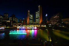 Toronto City Hall At Twilight .... Toronto, Ontario, Canada (Greg's Southern Ontario (catching Up Slowly)) Tags: nikon nikond3200 twilight dusk nathanphillipssquare reflectingpool torontocityhall cityhall water bluehour urban city canadiancity citylights nightlights