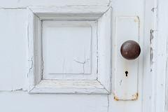 Vintage Wooden Door (Dolores Harvey) Tags: white door wooden wood antique vintage metal knob metalknob square newfoundland doloresharvey d800 deloresharvey canvassingtheneighbourhoodcom canvassingtheneighbourhood canvassingtheneighbourhoodphotography old cracked paint