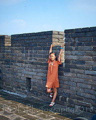 2018 Xi'an - On and Around the Old City Walls 56 (C & R Driver-Burgess) Tags: xian 西安 wall city towers ancient historical stone defense tourist child girl preteen young brown golden shift dress arms outstretched overhead embrasure battlements