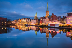 Christmas market in Lübeck (Michael Abid) Tags: lübeck lubeck luebeck night skyline germany christmas market weihnachtsmarkt weihnachten landmark schleswigholstein river canal trave architecture altstadt famous popular city hanseatic reflection church tower