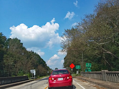 Entering Lumberton City Limits. (dccradio) Tags: lumberton nc northcarolina robesoncounty outdoor outdoors outside sky bluesky cloud clouds cloudformation tree trees greenery leaf leaves branch branches treebranch treebranches alamacroad toyota corolla lumbertonsign citylimits enteringlumberton bridge lumberriverbridge lumberriver roadsigns speedlimit 35mph construction constructionsign lowshoulder noshoulder rail paved pavement