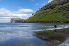 Tjornuvik beach (Marion McM) Tags: beach sea blacksand sand seastacks reflections children bluesky sky risin kellingin landscape faroes faroeislands stremoy canoneos760d