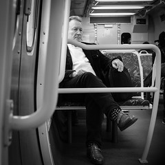Man on Train (Leon Sammartino) Tags: 27mm fujinon fujifilm street train melbourne metro stolen shot mono