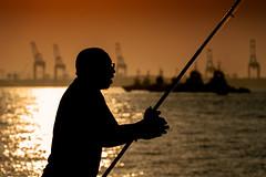 The Fisherman... (alvarolsalmeida) Tags: fisherman sunset redsky sky pescador riodejaneiro brazil brasil pôrdosol water agua fav50 fav100 fav150 ngc fav200 fav250