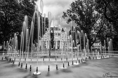 Lady of the Fountains (Gavmonster) Tags: gswphotography nikon d7500 nikond7500 ivanvazovnationaltheatre sofia bulgaria citygarden fountains statue blackandwhite bw monochrome greyscale grayscale longexposure milkywater architecture building theatre park trees water