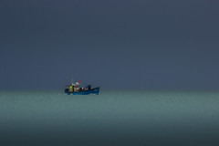 Homeward bound (snowyturner) Tags: boat fishing beach coast grey murky clouds home catch sea evening
