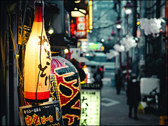 Evening at Omoide Yokocho (David Panevin) Tags: 思い出横丁 omoide yokochō 西新宿 nishishinjuku 新宿区 shinjuku 東京 tokyo japan olympus omd em1 mzuikodigitaled45mmf18 street path alley shops izakaya evening night lights signs lanterns urbanfragments bokeh bokehlicious davidpanevin