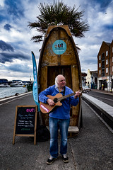 mark rocking the boat (Mark Rigler -) Tags: mark rigler guitar busker inside out dorset