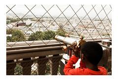 Explore the World (Thomas Listl) Tags: thomaslistl color human kid red fence net city cityscape paris france eiffeltower street urban telescope view ngc