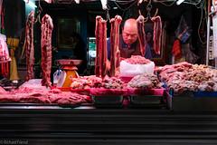 Butcher in Phra Khanong Market, Bangkok (Rich Friend) Tags: butcher meat food market street streetphotography bangkok asia thailand phrakhanong fuji fujixt2