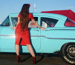 Holly_9236 (Fast an' Bulbous) Tags: classic american car chevy vehicle automobile girl woman hot sexy pinup model red dress high heels stockings nylons long brunette hair