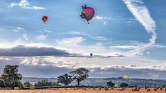 Balloons Oswestry (jayneboo) Tags: oswestry balloon festival shropshire skyt field crops harvest clouds bales hay
