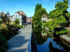 rue Schwendi (Colmar, F) (pietro68bleu) Tags: alsace maisonsàcolombages lauch banc lampadaire rivière colmar france perspective ville town sky ciel blue verdure greenery