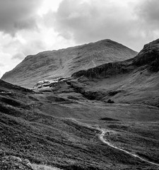 Glencoe ii (Niaic) Tags: glencoe scotland highlands britain mountains unitedkingdom hills mountain valley valleys terrain landscape monochrome blackandwhite trees outdoors grain grainy panasonic lx100 contrast countryside scenery scenic rugged cloudy clouds summer view