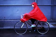 Go Ahead, Be A Communist (N A Y E E M) Tags: woman lady bicycle rain candid colors afternoon street jianguowestroad xuhui shanghai china