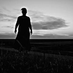 Silhouette of a Woman (d_t_vos) Tags: woman silhouette dark darkness sunset land horizon grass dike twilight arm arms earring earrings hands contrast cloud clouds cloudy outline outskirts hair skirt outside outdoor wad waddenzee waddensea wadden nieuwebildtzijl nijesyl friesland frisian frisiancoast coast silhouet skyline clairobscur dickvos dtvos