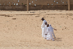 Returning from the Mosque, Dakar (Geraint Rowland Photography) Tags: religion muslim islam muslimsofwestafrica yoffbeach dakar senegal muslimsofsenegal beach mosquesofsenegal yoffmosque family tradition sunday prayer wwwgeraintrowlandcouk geraintrowlanddocumentaryphotography sand africanculture