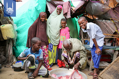 A family preparing their meat received for Eid al-Adha in Somalia