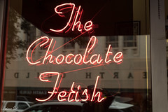 Sweet treat for the mid-week HWW (Irina1010) Tags: window sign neon thechocolatefetish store business sweets chocolate reflections canon urban