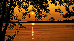 Smokey Confusion (Bob's Digital Eye) Tags: aug2018 bobsdigitaleye canon canonefs1855mmf3556isll glow glowing laquintaessenza lake lakesunset lakesunsets orange outdoor reflection silhouette skies sky smokepollution sun sunset sunsetsoverwater t3i water flickr flicker