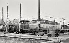 Bw Karlsruhe, January 1990 (rolfstumpf) Tags: germany deutschland karlsruhe betriebswerk bwkarlsruhe monochrome eisenbahn bahn br218 br360 218482 v60 365102 köfiii br998 railway railroad lokomotive diesellok locomotive