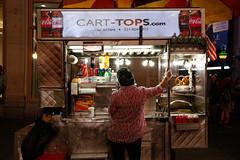 Late Night Shift. (Livia Lopez) Tags: newyorkcity manhattan foodcart vendor woman hijab photography street canon canont5i timessquare worker nightshooting cart