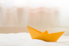 On smooth water (jettebaltzer) Tags: lifeisarainbow yellow boat origami