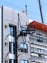 Working Windows (clarkcg photography) Tags: windows apartments building construction crane workers hanging balcony windowwednesday