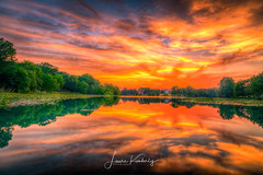 Indian Creek Sunset (laurakimberlyphotography) Tags: clouds colorfulsky creek foliage indiancreekingramtexas indiancreeksunset ingram ingramtexas laurabiernat laurakimberlyphotography lilypads orangesky reflection sky sunset texas trees water yellowsky facebookcomlaurakimberlyphotography wwwlaurakimberlyphotographycom