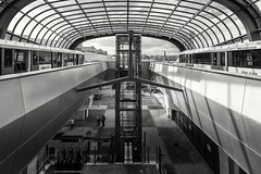 Noord/Zuidlijn station Noord B&W (Dannis van der Heiden) Tags: metro noordzuidlijn monochrome architecture station noord window roof elevator conductor entrance building amsterdam people bicycle car streetlight street brick sky clouds nikond750 d750 tokina1628mmf28 sunshine modern