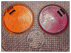 Street Metal Abstract (lorinleecary) Tags: lines pattern curves circles cambria texture abstract streetmetal california orange red