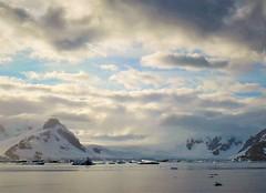 Morning on the Antarctic Peninsula. (Ruby 2417) Tags: morning mountain coast antarctica antarctic clouds sunlight ocean sea